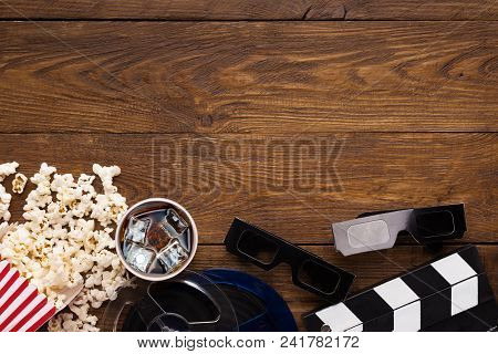 Cinema Background, Top View. Clapperboard, Popcorn, Soda And 3d Glasses On Wooden Table, Copy Space.