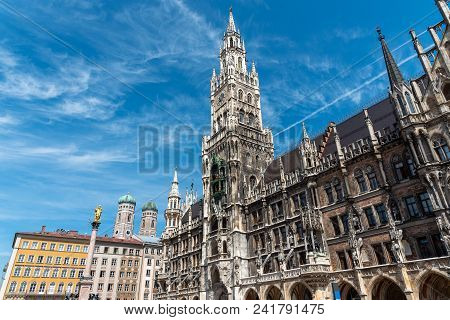 The Townhall At The Marienplatz In Munich With The Towers Of The Frauenkirche In The Back