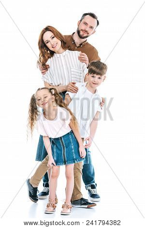 Cheerful Family With Two Kids Standing Together And Smiling At Camera Isolated On White