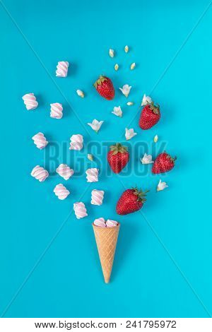Waffle Cone With Marshmallows, Fresh Strawberries And Flowers Jasmine Blossom Bouquets On Blue Surfa