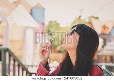 Travel Concepts. Beautiful Girl Is Playing Soap Bubble Fun. Asian Girls Are Relaxing Travels. Asian