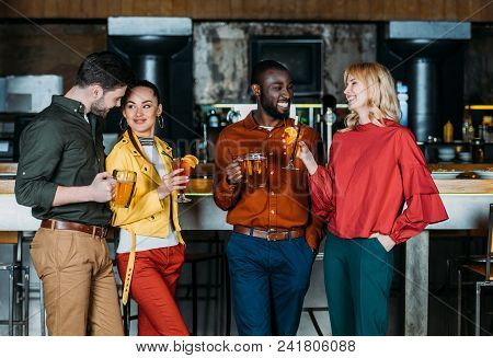 Group Of Friends With Mugs Of Beer Spending Time Together In Bar