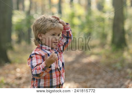 Child Portrait Smiling. Portrait Of Child. Funny Little Boy On Nature Background. Adorable Young Hap