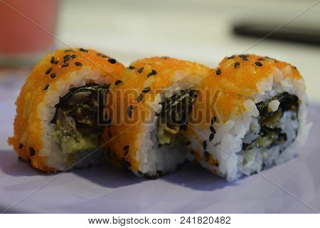 3 Sushi Makis With Masago Over A Plate