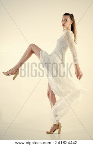 Fashion Woman Model Posing. Girl In White Fashionable Dress. Beauty And Fashion. Look And Fashion St