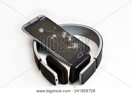 Mobile Phone Shattered And With The Screen Broken
