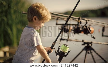 Child Childhood Children Happiness Concept. Little Boy Learn To Catch Fish In Lake Or River. Child W