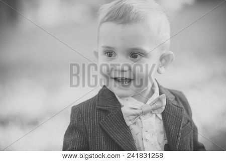 Childhood. Kid Fashion, Beauty, Style. Little Boy With Bowtie On Natural Landscape, Fashion. Child S