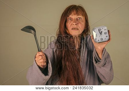 Woman With Long Hair Hold Alarm Clock And Spoon. Retirement And Pension. Household And Time Manageme
