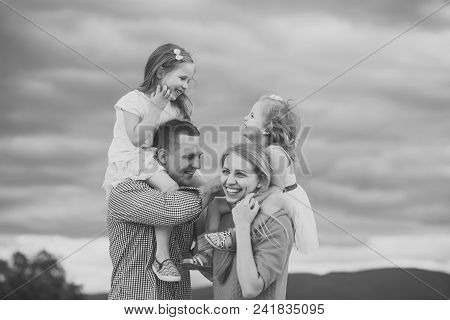 Child Childhood Children Happiness Concept. Girls Sit On Mother Father Shoulders On Cloudy Sky. Chil