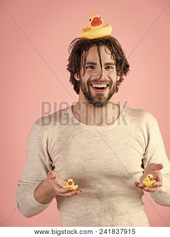 Fun Faces. Man Splash Water At Face On Pink Background. Man With Wet Hair And Duckling Washing Face.