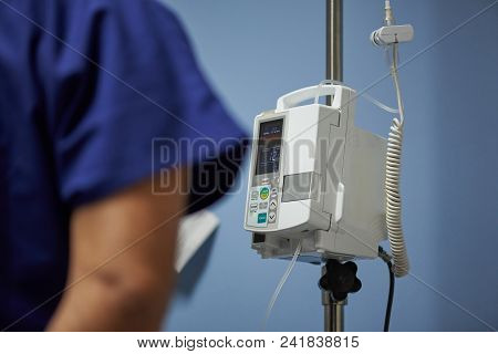 Doctor Checking Patient Parameters  On Digital Display