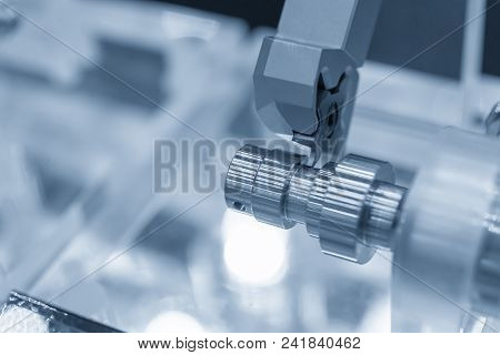 Close Up Of The Cnc Lathe  Machine Cutting The Groove At The Metal Shaft  Part In The Light Blue Sce