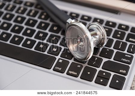 Stethoscope On Keyboard Countertop Ready For Use And Data Entry By Medical Professional