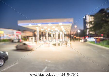 Abstract Blurred Gas Station In Houston, Texas, Usa At Blue Hour