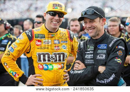 May 18, 2018 - Concord, North Carolina, USA: Matt Kenseth (6) and Kyle Busch (18) get ready to qualify for the Monster Energy All-Star Race at Charlotte Motor Speedway in Concord, North Carolina.