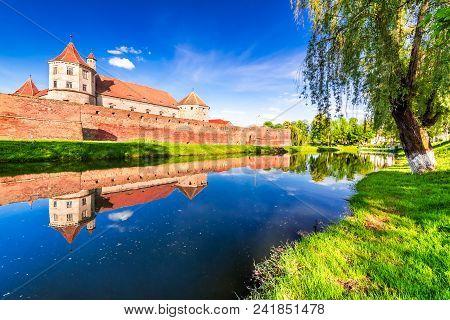 Fagaras, Romania. Spring Green Blossom Landscape With Fagaras Fortress, Transylvania.