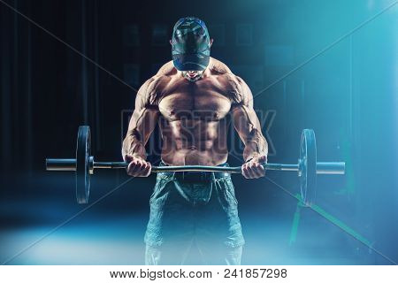 Strong Bodybuilder Athletic Man Pumping Up Muscles Workout Bodybuilding Concept Background - Muscula