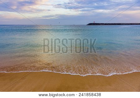 View of an empty beach in a overcast day in Sesimbra, Portugal
