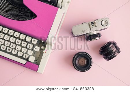 Flat Lay Of Pink Typewriter And Retro Camera With Lenses On Table Minimal Creative Concept.