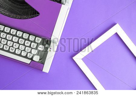 Retro Vintage Typewriter And Photo Frame Violet Minimal Creative Concept.
