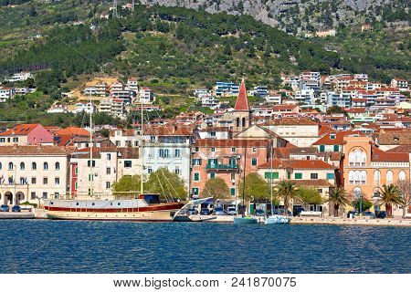 Makarska Boats And Waterfront Under Biokovo Mountain View, Dalmatia Region Of Croatia