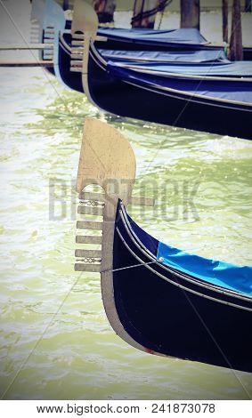 Ancient Bows Of Venice Gondolas In The Grand Canal