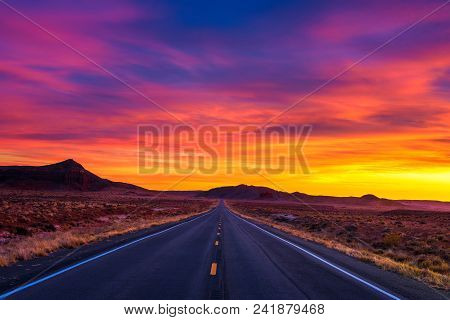 Dramatic Sunset Over An Empty Road In Utah Near Its Border With Arizona, Usa