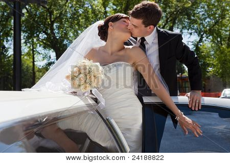 Passionate married couple kissing