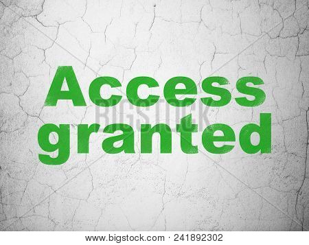 Safety Concept: Green Access Granted On Textured Concrete Wall Background
