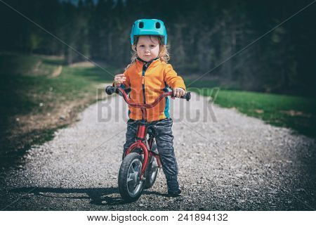 cute little girl training cycling on rural road lomo style picture