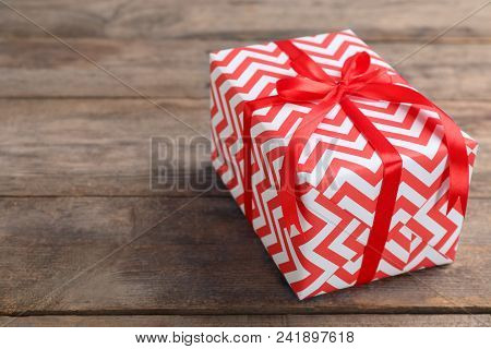 Elegant Gift Box With Bow On Wooden Background