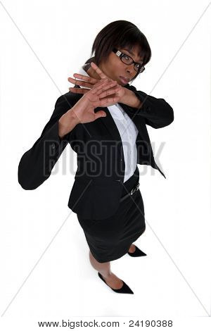 black woman in suit trying to fend off male assault