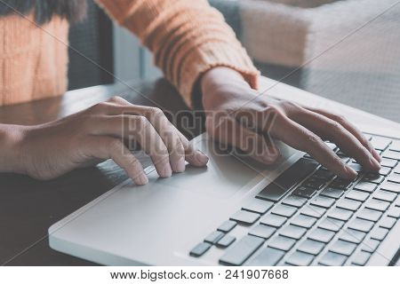 Woman Freelancer Is Working And Hands Typing Keyboard On A New Project On Laptop Computer In Cafe