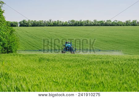 Agricultural Sprayers, Spray Chemicals On Young Wheat.spraying Pesticides On Wheat Field With Spraye