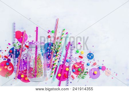 Milkshake Straws, Glass Jar, Confetti And Candies Close-up In A Colorful Party Supplies Concept On A