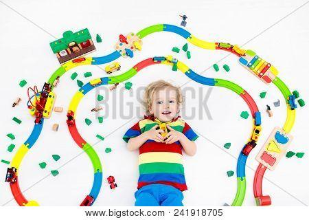 Child With Toy Train. Kids Wooden Railway.