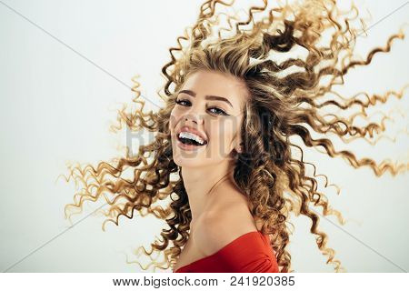 Woman With Happy Face And Curly Hair. Portrait Of Funny Positive Girl With Curly Hair Isolated On Wh