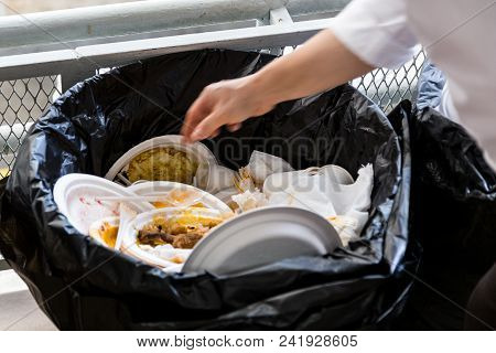 Environment Unfriendly Styrofoam Plates And Cups In Plastic Garbage Bag