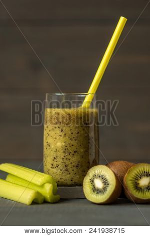 Green Smoothies From Kiwi In A Glass And Pieces Of Kiwi And Celery