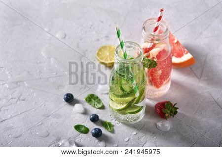 Infused Detox Water, Healthy Refreshing Drink With Lime, Grapefruit, Berries And Mint