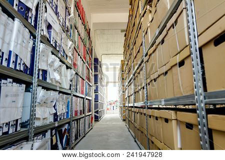 Stacks Of Files And Paperwork Placed In Bookshelves With Folders And Documents In Binders And Cardbo