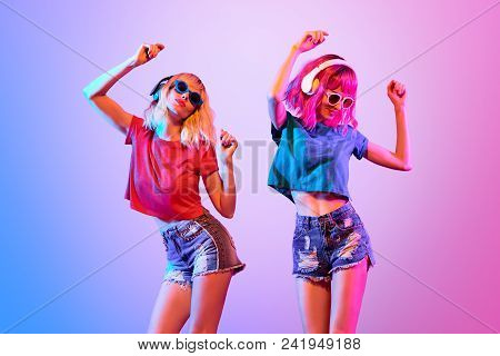Dj Girl With Pink Blond Fashion Hairstyle Dance. Two Young Playful Hipster In Trendy Headphones. Sex