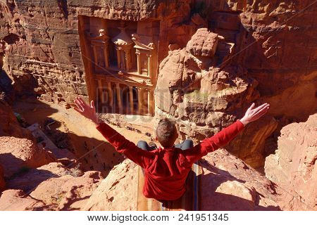 Treasury From Above With A Young Man. Al Khazneh In The Ancient City Of Petra, Jordan, Unesco World