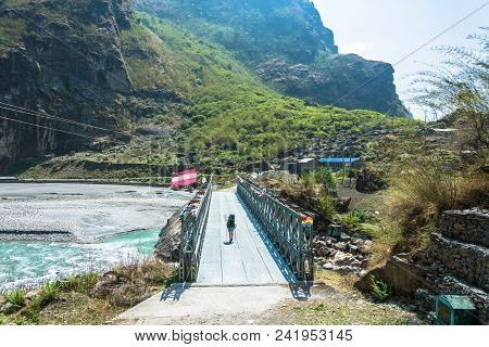 Bridge Over The Mountain River In Nepal.