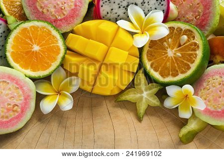 Bright Colorful Tropical Fruits (mango, Tangerine, Guava, Dragon Fruit, Star Fruit, Sapodilla) With