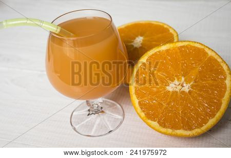 Glass Of Fresh Orange Juice,ripe Orange Fruit And Slices On Rustic Wooden Table.freshly Squeezed Ora