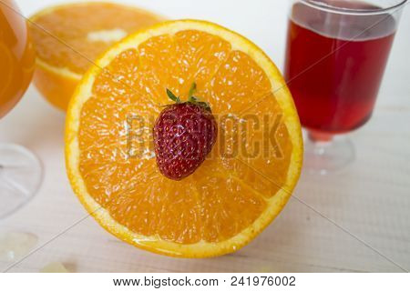 Glass Of Fresh Orange And Strawberry Juice,ripe Orange Fruit And Slices On Rustic Wooden Table.fresh