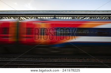 Long Distance Express Train Departing A Uk Station