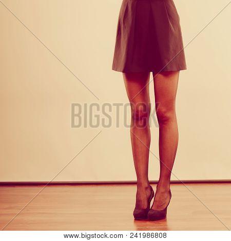 Part Of Body People Concept. Beautiful Woman Long Legs. Black Elegant Skirt And Dark High Heels.
